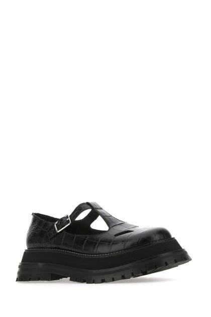 Black leather flat shoes