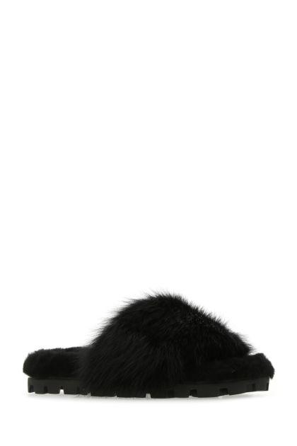 Black shearling slippers