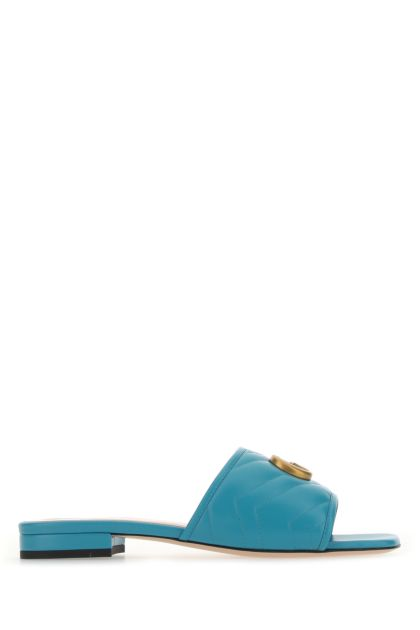 Turquoise leather slippers