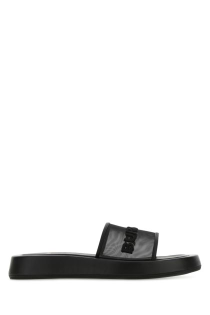 Black mesh and leather slippers